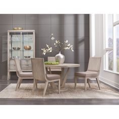 Complete Your Contemporary Dining Room With This Round 5 Piece Dining Set  From RC Willey.