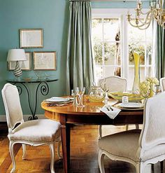 Pretty Persuasion The rich textures of this dining room -- the cool robin's egg blue of the walls, the warm wood of the floors, and the velvety                          fabric of the upholstered chairs -- make it inviting. Just add candlelight, and you'll feel like you're in the middle of a                          Jane Austen novel.