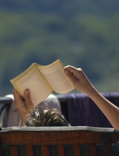 wanna catch some sun rays but cant read the book so I hold the book so it blocks the sun until my arms get tired.