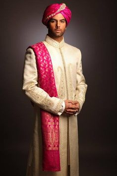 #Knotsandhearts | This splendid ensemble is an astonishing work of art by the acclaimed fashion designer Deepak Perwani. The regal looking sherwani is beautifed with the touch of soothing cream color. To add a bit of royalty this ace designer has crafted embroidery of zari on sherwani. To compliment, the ace designer have teamed a pink dupatta and turban with sherwani, which is making the look a lot more majestic.   http://www.pinterest.com/knotsandhearts/best-wedding-dress-designers/
