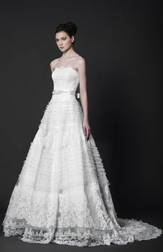 Strapless Off-White ball gown with an illusion ruffled skirt made of Tulle and Lace, featuring an embellished belt.