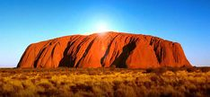 """The story of Australia's Uluru, also known by its colonial name """"Ayers Rock""""  """"Uluru is an inselberg, literally """"island mountain"""", an isolated remnant left after the slow erosion of an original mountain range"""" . . . """"the second-largest in the world (after Mount Augustus, also in Australia),"""""""