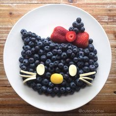 Food Art. Hello Kitty is high on antioxidants--blueberries. and like OMG! get some yourself some pawtastic adorable cat apparel!