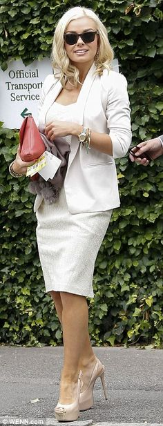 Smart: The 33-year-old singer wore a cream dress and blazer for her afternoon at the tennis
