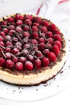 Dark Chocolate Raspberry Cheesecake - The creamiest, most delicious cheesecake you will ever make. All the delicious toppings hide any cracks so it always looks perfect! From aberdeenskitchen.com. #cheesecake #dessert #baking #chocolate #valentinesday