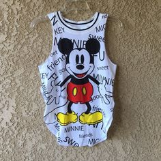 NWT Mickey Mouse Tank Top Brand new with tags still attached. Large arm holes Disney Tops Tank Tops