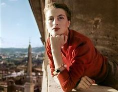 © Robert Capa/International Center of Photography/Magnum Photos. - Robert Capa, [Capucine, French model and actress, on a balcony, Rome] Magnum Photos, Color Photography, Vintage Photography, Portrait Photography, Rome Photography, Classic Photography, Minimalist Photography, Contemporary Photography, Urban Photography