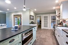 Sherwin Williams Oyster Bay on the walls, beautiful kitchen with plenty of light and french doors