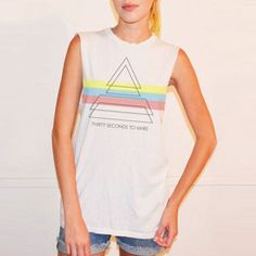 This new stylish tee is exclusive to the Mars Store!  Features a new triad design with tri-color details printed on the front, with THIRTY SECONDS TO MARS text across the chest.  Girls - wear this with leggings or your favorite jeans!  Guys - this looks great with shorts or your favorite pants.  100% lightweight cotton, made in Los Angeles, California, and made by (goodhYouman).