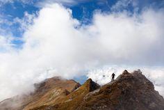 Hiking among the clouds in Switzerland (Photo: Arno Balzarini / EPA)