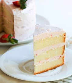 Lemon Cake with Strawberry Butter Cream Icing - This Lemon Cake with Strawberry Buttercream recipe has multiple good things going on. Layer after layer of zesty and moist cake is sandwiched between creamy, sweet and smooth strawberry icing for a tangy and sweet fruit flavored dessert. A great sweet treat for the spring and summer months and holidays like Easter, Mother's Day and Memorial Day picnics. Perfect for parties and bridal and baby showers, but a great after dinner dessert just for…