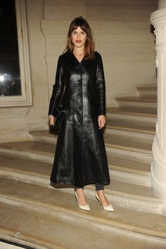 Jeanne Damas in a Fall/Winter 2015-16 coat to the Valentino Haute Couture Spring/Summer 2016 fashion show on January 27th 2016.