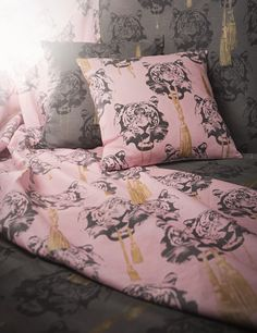 """Coco tiger-  a crazy yet sober and elegant pattern - just like a tiger. """"- i have always been fascinated by animals and natures own patterns. i let the animal like meet luxury, and with a bit of inspiration from the fashion world a crazy and exciting coco tiger came about!"""" says lisa about the new pattern. the wallpaper is available in both pink and grey with details in gold."""