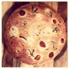 Cheese and onion bread garnished with tomato slices and lavender stems, serve with homemade butter
