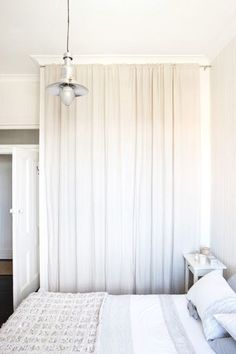 Take out the closet doors and use a curtain rod to hang two white curtains instead to hide closet items add crown molding. Such a good idea for my small bedroom! Curtains For Closet Doors, Bedroom Closet Doors, Bedroom Wardrobe, White Curtains, Bedroom Storage, Bedroom Curtains, Curtain Wardrobe Doors, Curtain Closet, Ikea Closet