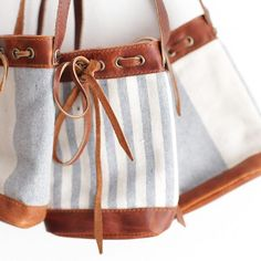 www.mikoleon.com  Tiny handbags. Her Mini Bucket bag. Leather and up-cycled denim. Join us to save 20% link in profile.