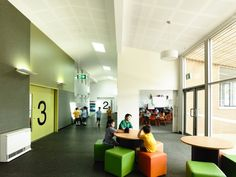 Birralee Primary School / Kerstin Thompson Architects, shared learning, kids, perf gyp, skylights, hall, classrooms, tack, uplighting, round pendant fixtures