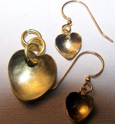 Brass heart pendant and matching earrings.  Heart is 18 mm, earrings are 10 mm.  all are hand made in our shop.  https://handmadeartists.com/shop/rasmussengems