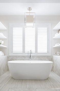 Neutral light bathroom + freestanding tub with floor mounted tub faucet + large window over the tub + open shelving on either side of the tub + white and off white bathroom Master Bathroom Tub, Bathroom Windows, Bathroom Renos, Bathroom Flooring, Light Bathroom, Bathroom Ideas, Bathroom Tubs, Bath Tubs, Bath Ideas