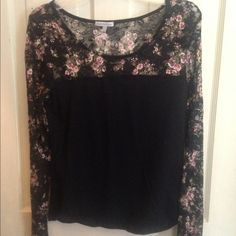 Long sleeved shirt with laced at top Long sleeve black shirt, with floral lace at top and on sleeves. Perfect condition. No wear and tear damage. Is a size large but fits likes a medium Charlotte Russe Tops Tees - Long Sleeve