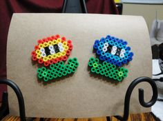 A SUPER MARIO FIRE FLOWER PERLER BEAD GREETING CARD (ENVELOPE INCLUDED). Perfect for someones birthday, a Christmas gift, just saying hello card, etc.