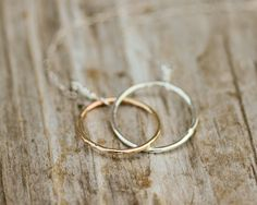 The infinity necklace with gold and silver interlocking rings from Amy Waltz Designs is delicate, but still with an edge, thanks to the hammered metal look. The interlocking rings in different metals symbolize the way that we come together despite our differences. The perfect gift for a friend, a sister, a daughter, or a partner.