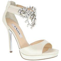 Nina Fabiloa crystal wrapped ankle pumps.
