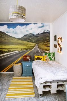 Love the mural on the wall for a great boy's room