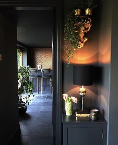 Eclectic, Dark & Glamorous Home Tour - Sally Worts | By decorating in one predominate colour like Sally has throughout her home ensures there are no visual barriers between rooms, which in turn helps you to see further into the connecting rooms and can actually make a space feel larger than it actually is. #eclectichome #darkinteriors #darkdecor #homedecor #interiors #interiordesign #eclecticdecor #styleitdark #interiorinspo #decor #lighting #ecleticinteriors #interiorinspo #decor