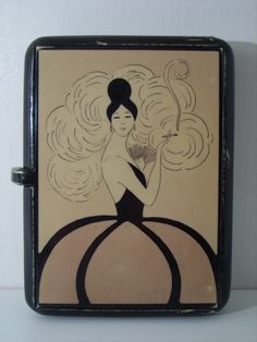 French bakelite cigarette case.Lady with fan smoking cigarette.