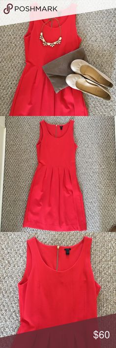 """J. Crew Coral pleated flare dress J. Crew brilliant flame colored tank dress with back gold zipper. Worn once. It's a thicker stretchy material. A-line silhouette. Falls above knee, 35 1/2"""" from high point of shoulder (based off size 8). J. Crew Dresses"""
