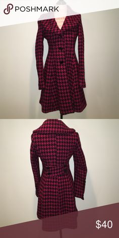 Stylish houndstooth long winter coat Stylish pink/ black houndstooth winter coat, long length, looks get over everything, very warm, excellent condition. Fully lined black interior, this jacket never goes out of style. Express Jackets & Coats