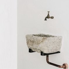 Love the old stone sink we found for the little bathroom off the living room.