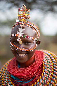 Traditional Maasai headpiece. When staying at Loisaba Tented Camp you find a true balance between people, landscape, culture and the wildlife. Set in the stark Samburu area of north central Kenya, the lodge aims to touch your mind, body and soul while on safari in this unique and beautiful land. Timbuktu Travel