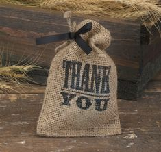"""Use these Burlap Favor Bags for your eco-friendly wedding, bridal shower or special event.  You can put a special treat in them for your guests or use them for the candy buffet at your event.  These burlap bags are simple, yet beautiful, and come complete with a twine drawstring closure, a black 3/8"""" satin ribbon and an """"Thank You"""" design printed in black.  Each package includes 25 favor bags."""