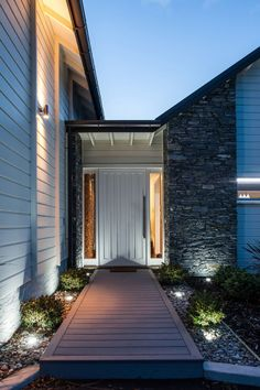 Rusticated weatherboards protect the home and provice a nice contrast with the schist stone
