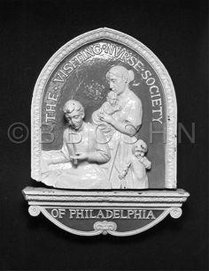 A ceramic plaque of the Visiting Nurse Society of Philadelphia, c. 1980. Image courtesy of the Barbara Bates Center for the Study of the History of Nursing.