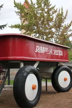 """A great photo of the """"world's largest"""" Radio Flyer Wagon - located right here in downtown #Spokane.  Built in 1990, the sculpture is made of 26 tons of steel and reinforced concrete.  It stands 12 feet high and is 27 feet long.  The wagon can hold as many as 300 people."""
