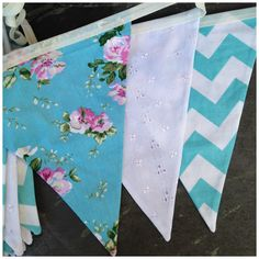Turquoise and white bunting  Creative Wedding Workshop has a large stock of bunting hire available in the Hampshire and West Sussex area we also offer a postal hire service.  Tithe barn Petersfield, Manor Barn,  Southend Barns, Skylark Country Club, Veils and Bales Hampshire