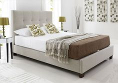 Elegant upholstered bedstead with hidden storage  Tall buttoned headboard and tapered legs are modern and stylish  Platform base for support and ventilation