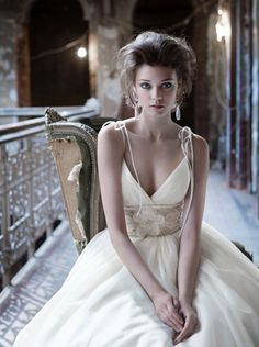 Style LZ3165Ivory silk organza bridal ball gown, ballerina sweetheart bodice with tied spaghetti strap at shoulder, beaded floral cummerbund at natural waist, gathered skirt with side pockets, chapel train. Dress available in Ivory and White