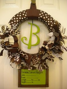 I love this wreath!! It is for a baby, of course, but you can leave the birth announcement off.