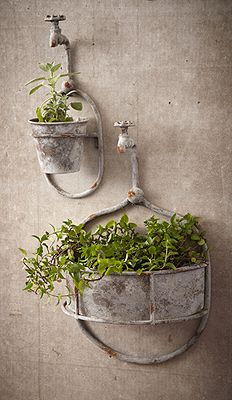 Two's Company Water Spout Flower Pots: Set of 2 water spout hanging flower pots in antiqued iron.  A unique home decor accessory made just for Two's Company.  Smaller is 6 1/4