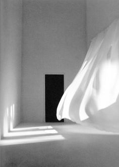 """White room."" Interior. White curtains."