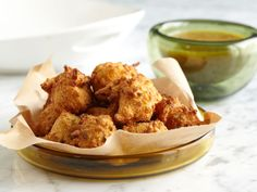 Cayenne give these hush puppies a punch—serve with the orange dipping sauce to cool the tongue.