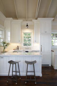 Amazing white #Kitchen with great Ceiling design. http://www.remodelworks.com/