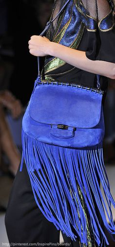 A Gucci fringe bag that combines the practicality of a satchel with the PURE MIND-BLOWING FIERCENESS of a leather jellyfish tail. --- PLEASE SOMEONE BUY ME THISSSS