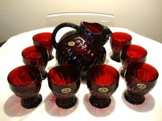 Anchor Hocking royal ruby swirl glass pitcher and tumblers. Produced from 1938 to 1940.