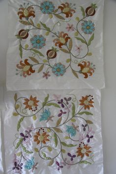 Deborah Kemball does beautiful applique...often with embroidered detail