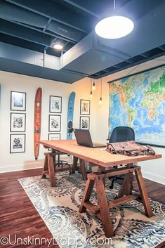 The Basement Man-Office is Complete!  basement before and after with renovations complete- painted ceiling, vinyl flooring, really cool collage and giant map for decorations